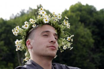 Man with flower crown