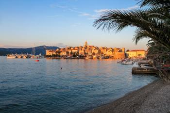 Medieval Town at Sunset with Palm Trees and Beach