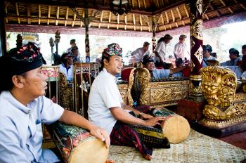 Men play traditional gamelan percussion