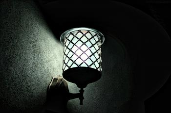 Metal Sconce Light Switched on during Night Time