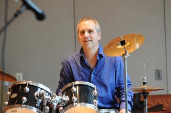 Michael Jordan (drummer) smiling, looking forward left