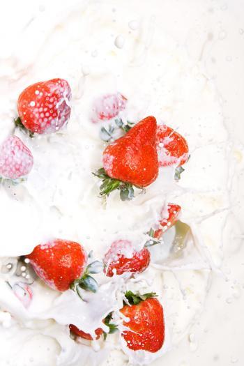 Milk and strawberries splashing