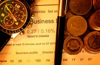 Money with pen and watch