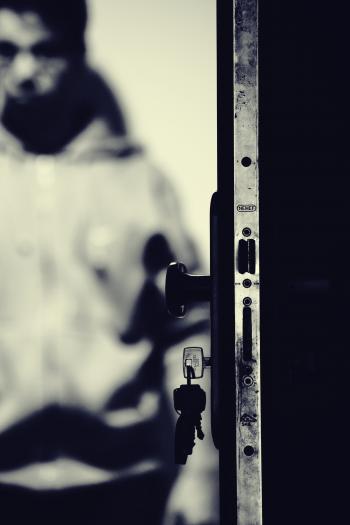 Monochrome Photo of Keys and Door Knob
