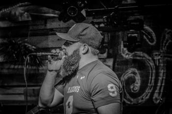 Monochrome Photography of a Man Singin