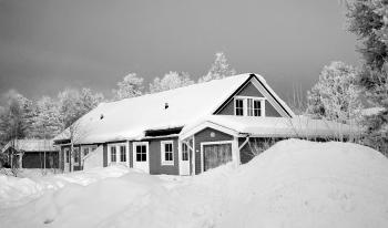Monochrome Photography of Snow Capped House