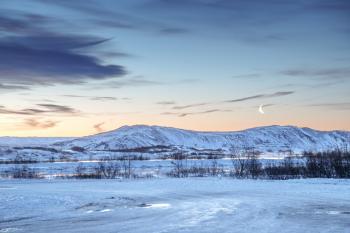Moonrise in Þingvellir during twilight