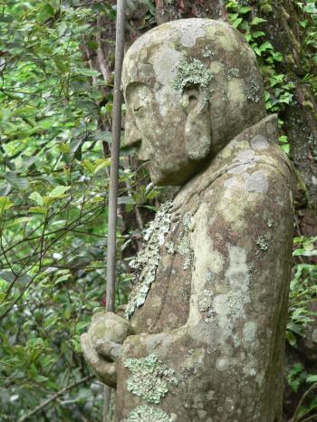 Moss covered Japanese Jizo Bodhisattva statue