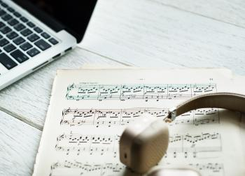 Musical Sheet Beside Laptop