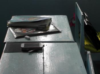 Notebook and Phone on a School Desk