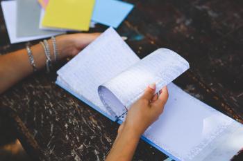Notebook in hands