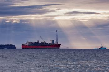 Oil and gas FPSO at sunset