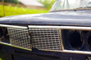 old broken car headlight