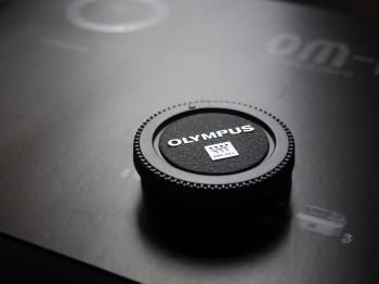 Olympus Camera Lens Cap Placed on Box
