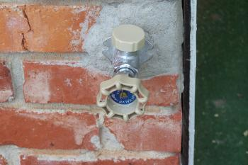 Outdoor Water Faucet on Brick