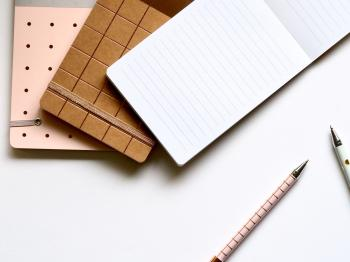 Pad With Pens on Table