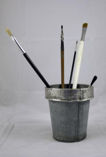 Paint brushes in tin can