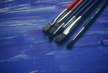 Paint Brushes on Blue