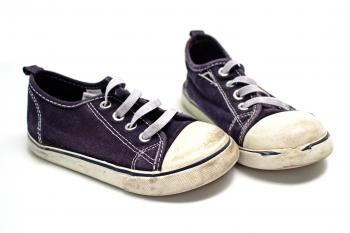 Pair of blue and white sneakers