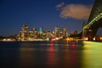 Panoramic Photography of Metropolis Next to Bridge during Night Time
