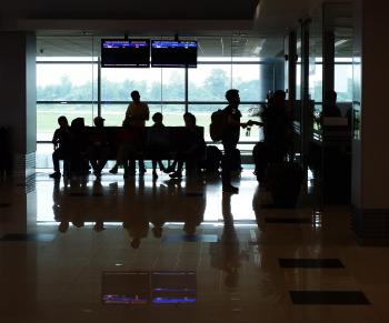 Passenger Silhouettes at Airport