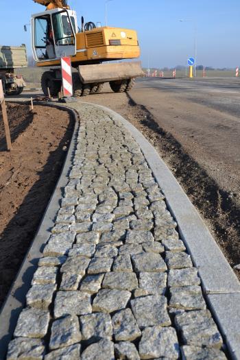 Pavement and excavator