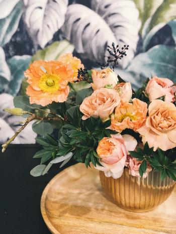 Peach Peony Flowers and Pink Poppy Flowers in Vase on Table Centerpiece