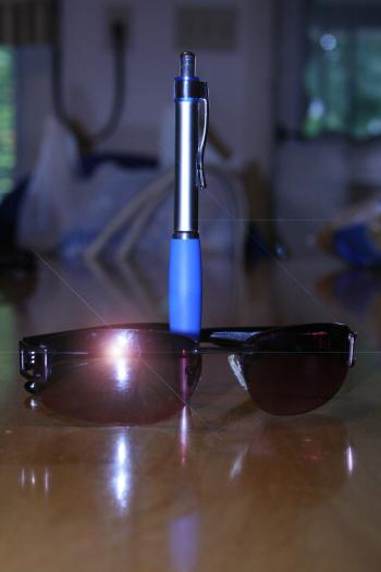 Pen and sunglasses