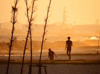 People On the Beach at Sunset