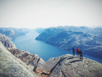 People on Top of Mountain Range