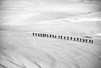 People Walking on Snow Field Grayscale Photography