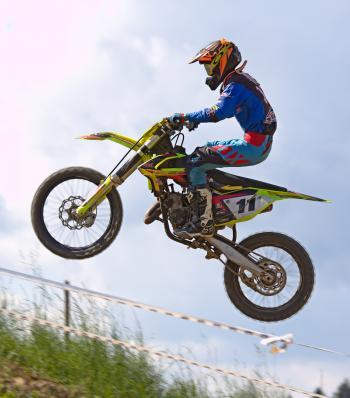 Person Doing Stunt in Motocross Dirt Bike