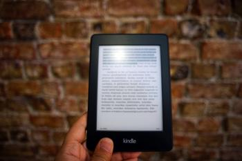 Person Holding Amazon Kindle Ebook