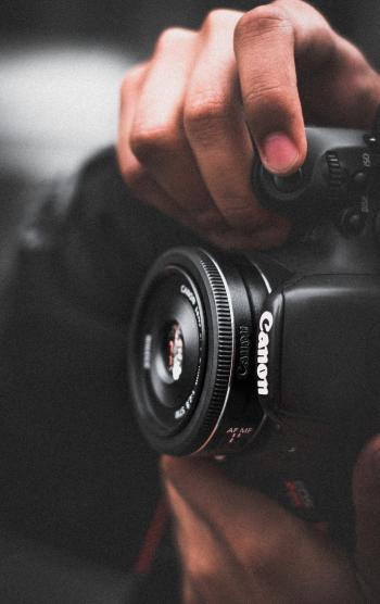 Person Holding Black Canon Dslr Camera Shallow Focus Photography