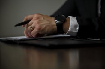 Person Holding Black Pen