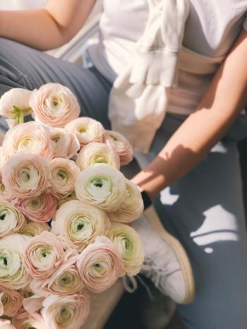 Person Holding Bouquet of Pink and Green Flowers