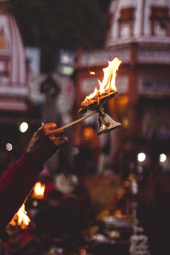 Person Holding Lamp With Flame