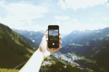 Person Holding Space Gray Iphone 5s Taking Picture of Mountains