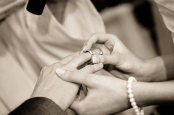 Person Putting Ring on Another Person in Grayscale Photography