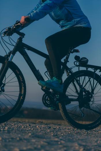 Person Riding on Black Mountain Bike during Night Time