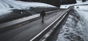 Person Running on Asphalt Road