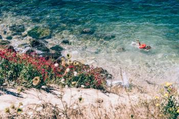 Person Swimming on the Beach Photography