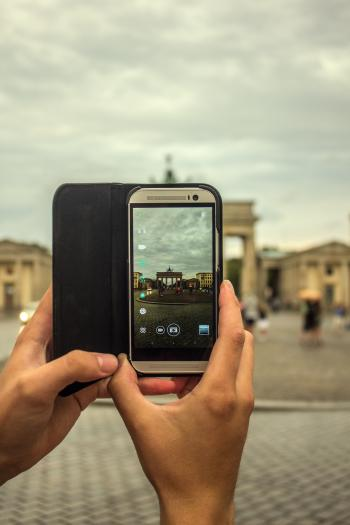 Person Taking Picture Using Gray Smartphone