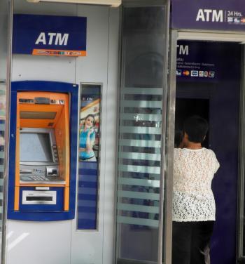 Person Using an ATM Machine