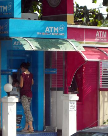 Person Using an ATM Machine