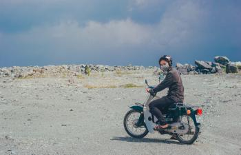 Person Wearing Mask on Motorcycle