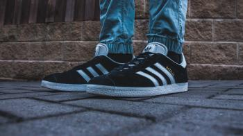 Person Wearing Pair of Black-and-white Adidas Gazelle