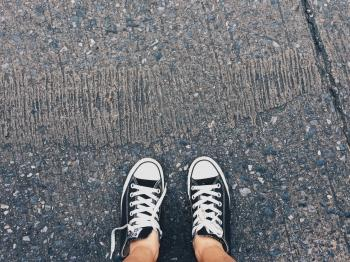 Person Wearing Pair of Black-and-white Converse All Star Low Sneakers