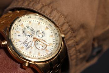 Person Wearing Silver Linked Chronograph Watch