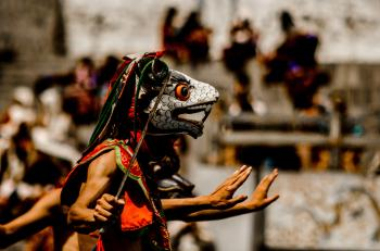 Person Wearing Traditional Mask Dancing